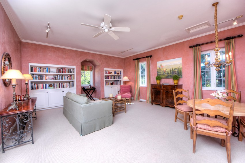 large room with pink walls